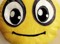 Plush filled smiley face pillow
